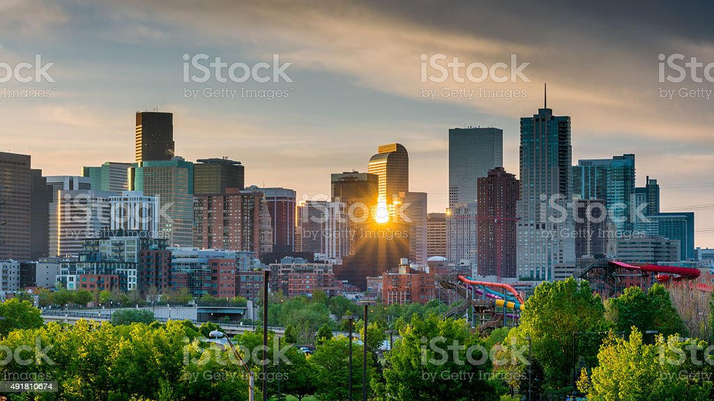 Sunrise peeks through the skyline of Denver stock photo