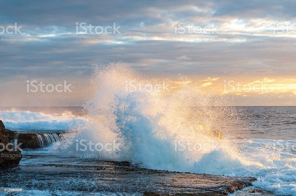 Sunrise power surf wave stock photo