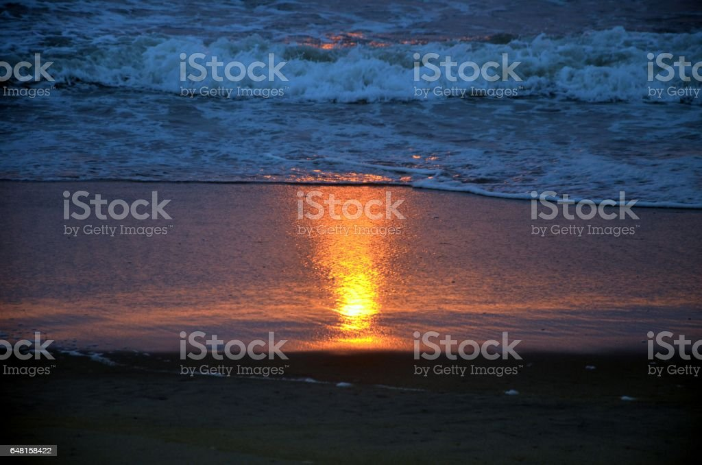 Sunrise reflection in sea beach stock photo