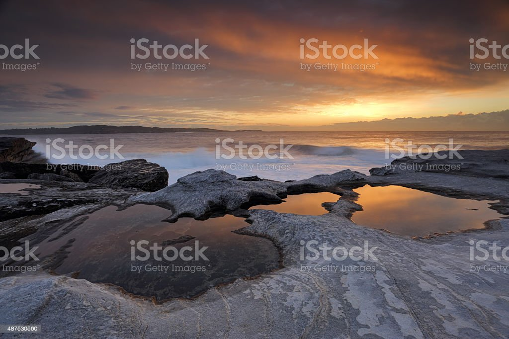 Sunrise reflections at Yena stock photo