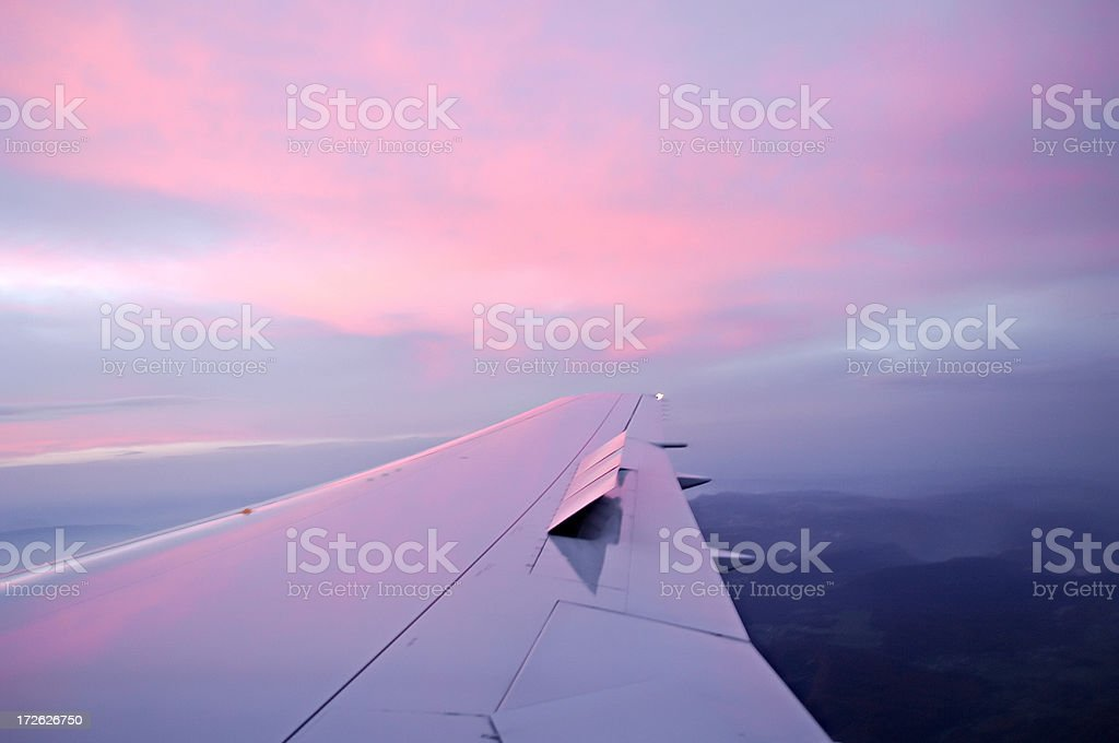 sunrise reflections on an airplane wing royalty-free stock photo