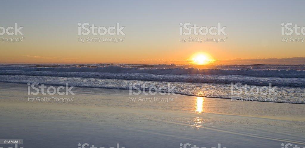 Sunrise scene at the beach watching waves royalty-free stock photo