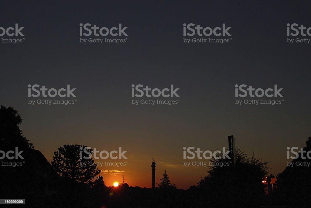 Sunrise setting over the city skykline stock photo