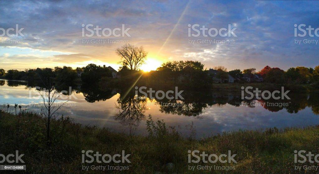 Sunrise shine over reflecting lake stock photo