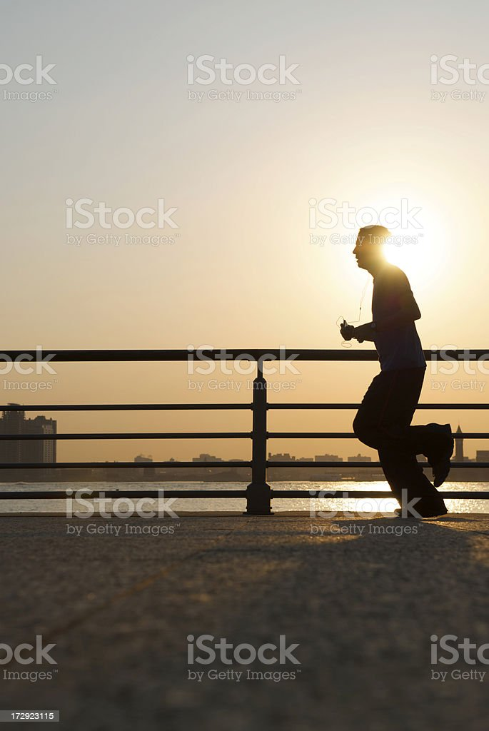 Sunrise Silhouette of Jogger w Headphones royalty-free stock photo