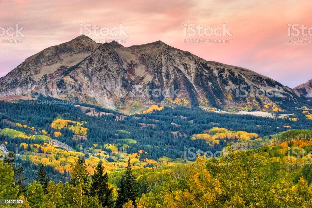 Sunrise Sky, Mountain, and Autumn Aspen stock photo