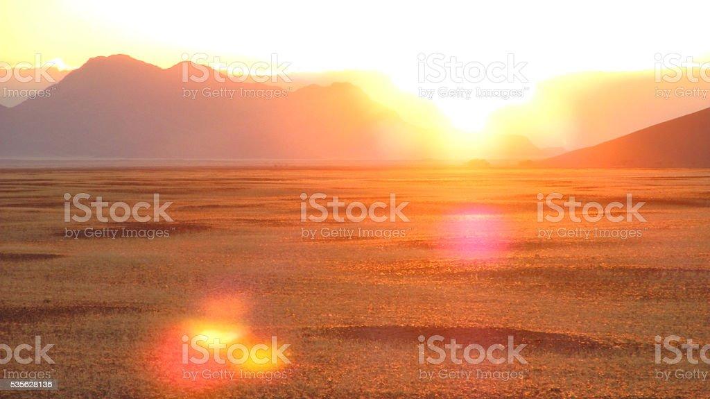 Sunrise sun sunbeam sunset dawn dusk desert landscape Namibia stock photo