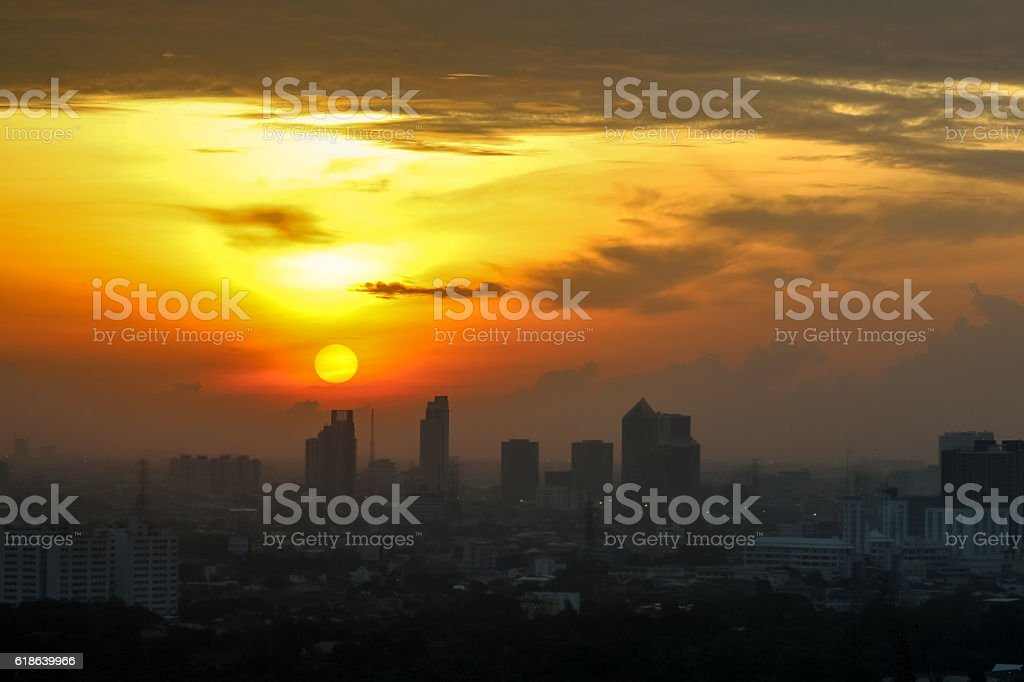 Sunrise sunset in the city with selective focus the sun stock photo