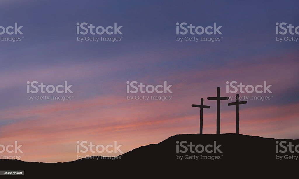 A depiction of the three crosses of Calvary with a beautiful sunrise...