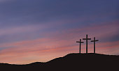 Crosses Of Calvary With Sunset