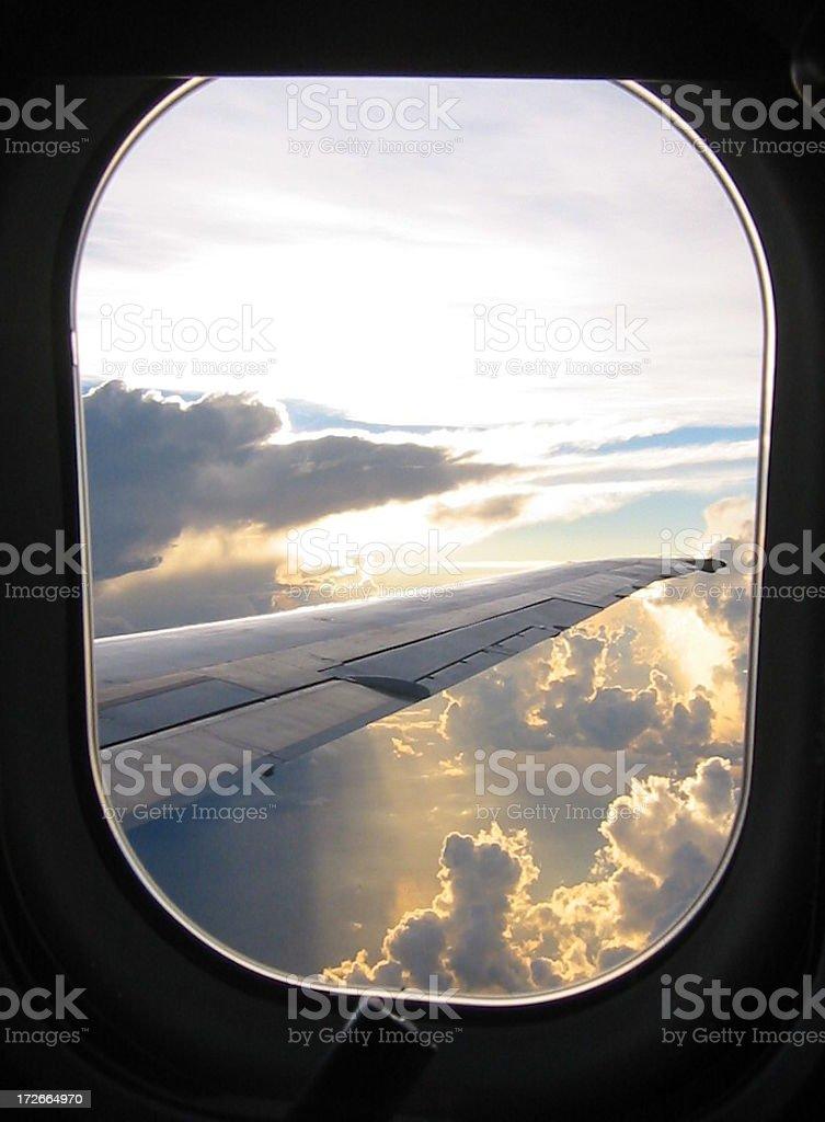 Sunrise through airplane window royalty-free stock photo