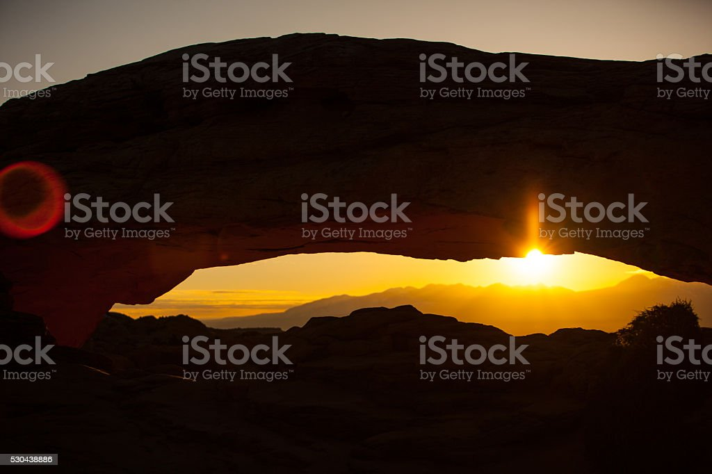 Sunrise through Mesa Arch in Canyonlands National Park stock photo