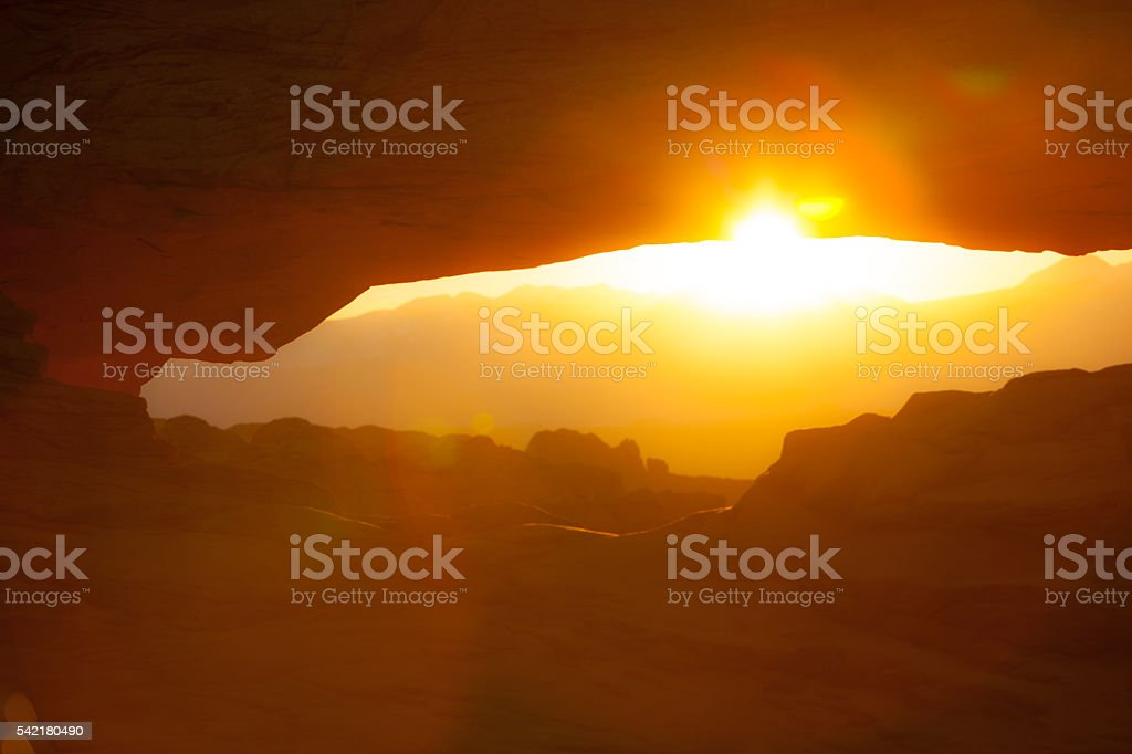 Sunrise through Mesa Arch in Canyonlands National Park. stock photo