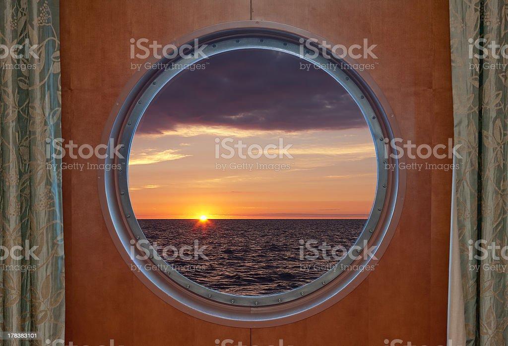 Sunrise Through Porthole stock photo