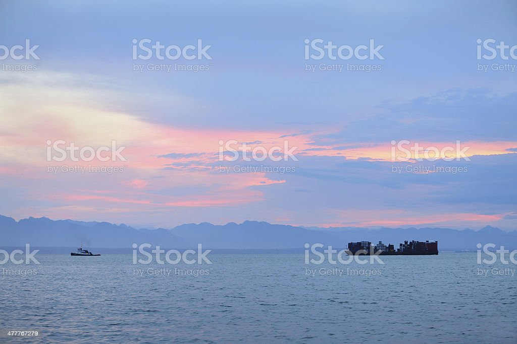 Sunrise Tugboat and Barge, Georgia Strait royalty-free stock photo