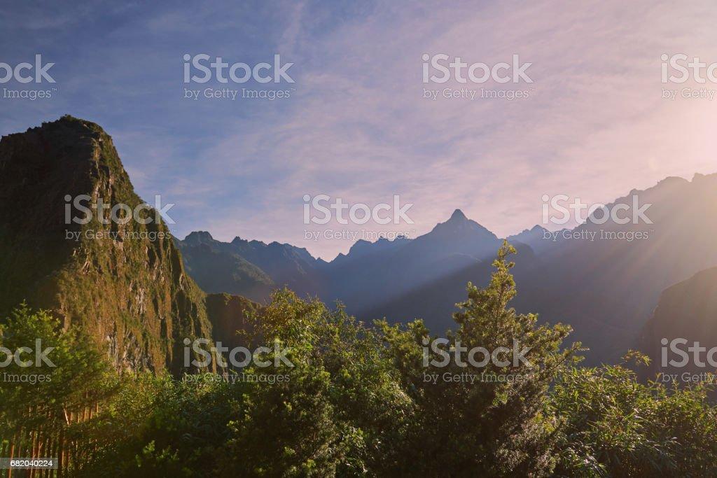 Sunrise under machu picchu mountains stock photo