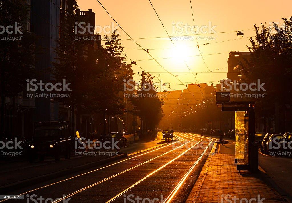 Sunrise urban tramstop stock photo