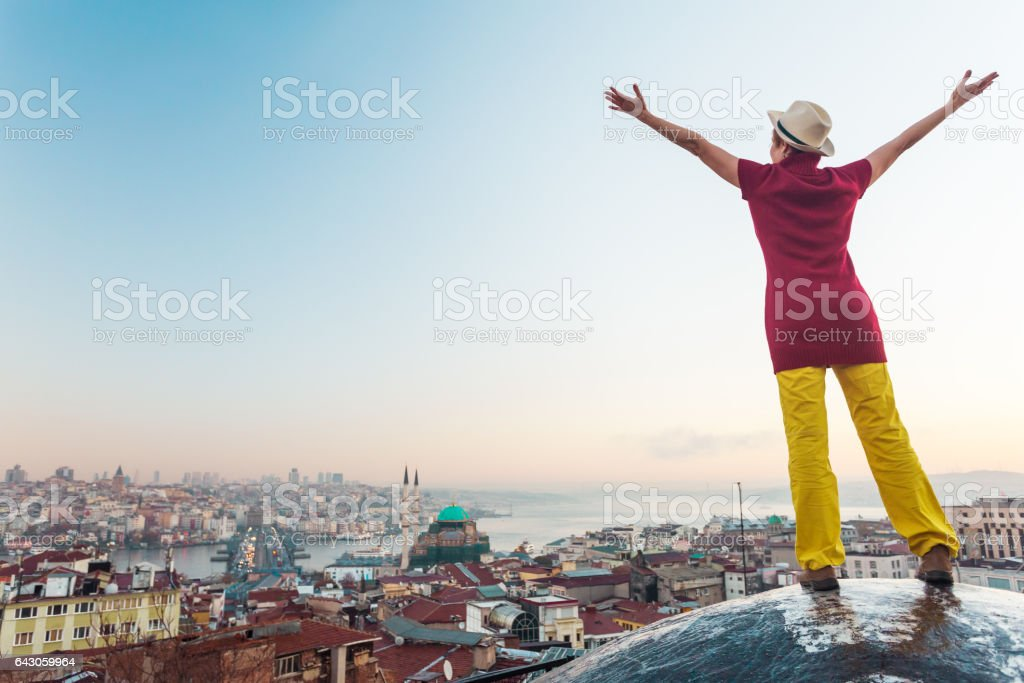 Sunrise View of large eastern City Woman raising Hands stock photo