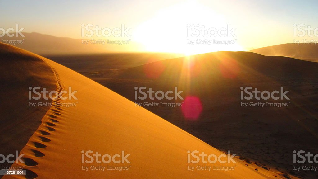 Sunrise walking over Dude 45 in Southern Namibia stock photo