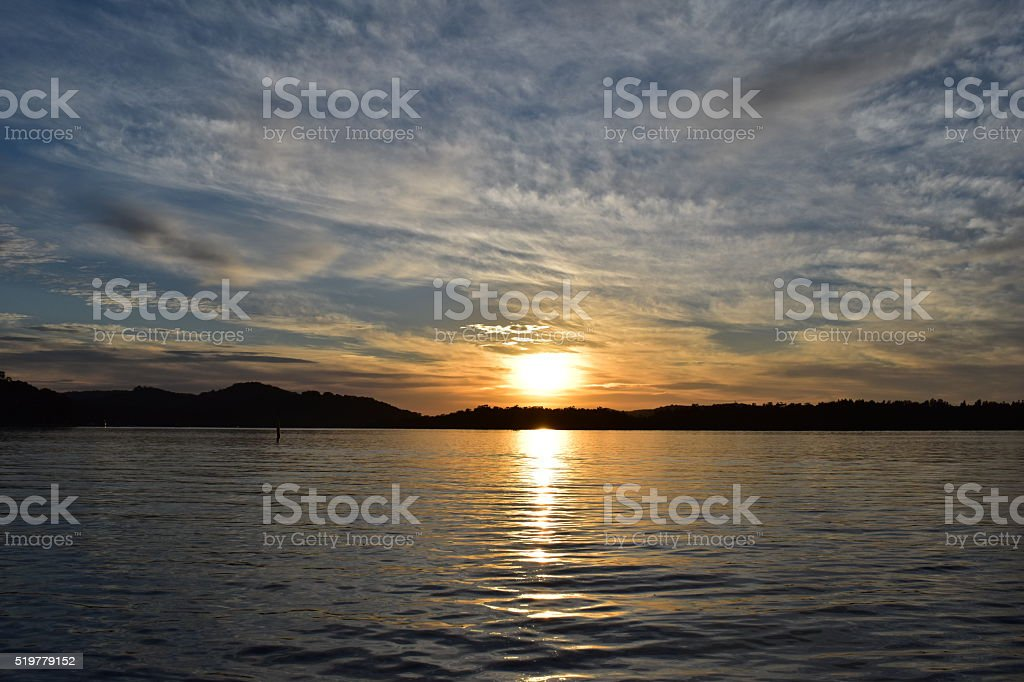 Sunrise waterscape and clouds stock photo