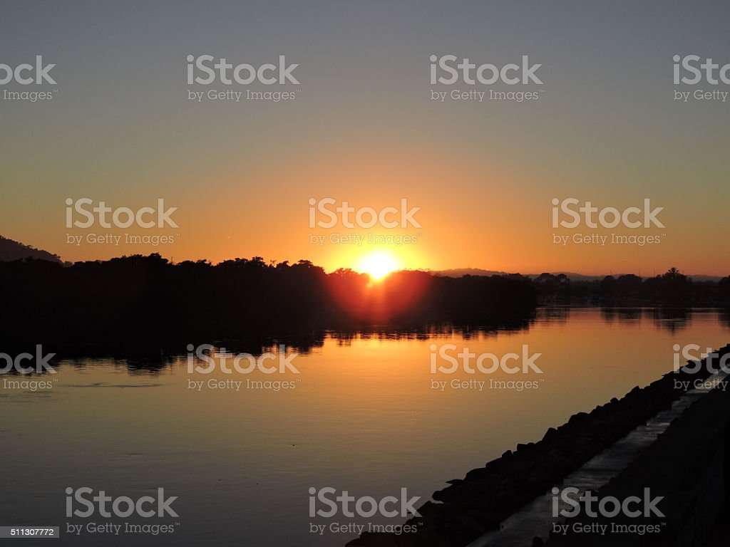 Sunrise waterscape with tree reflections stock photo