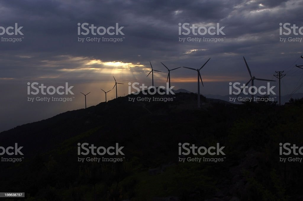 Sunrise windmill silhouette royalty-free stock photo