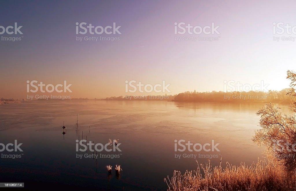 sunrise winter landscape of a lake stock photo