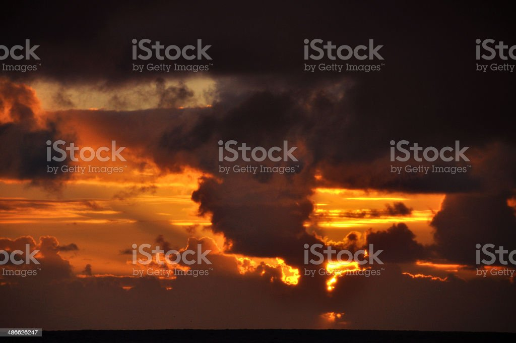 Sunrise with face in clouds royalty-free stock photo