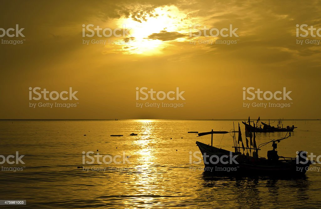 Sunrise with fishermen boats silhouettes royalty-free stock photo