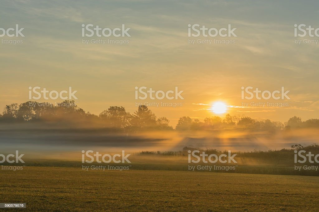 Sunrise With Ground Fog stock photo