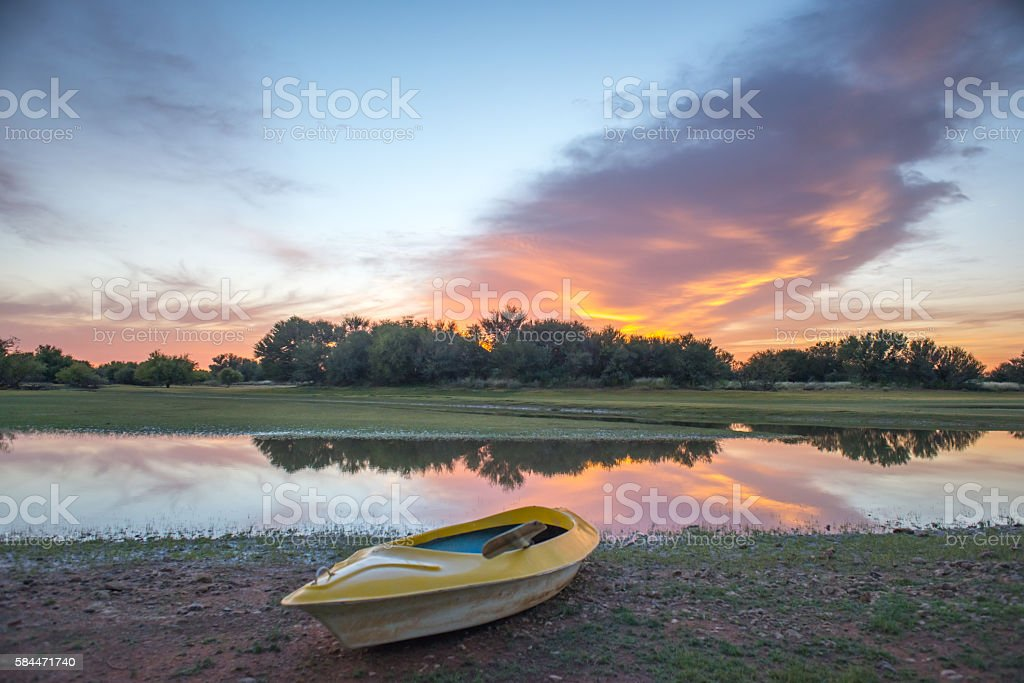 Sunrise with Kayak in foreground stock photo