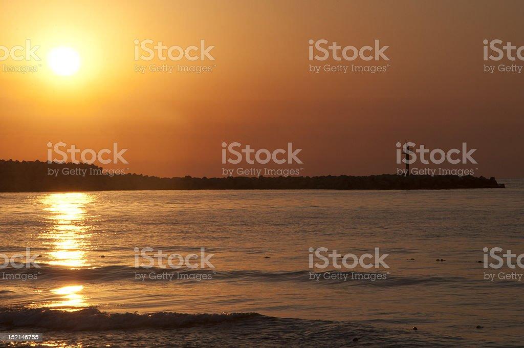 Sunrise with lighthouse royalty-free stock photo