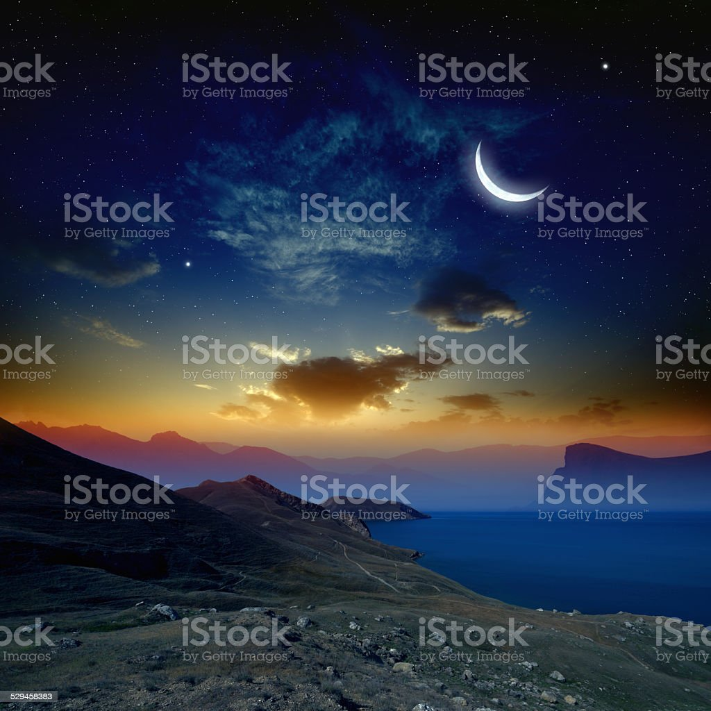 Sunrise with moon stock photo