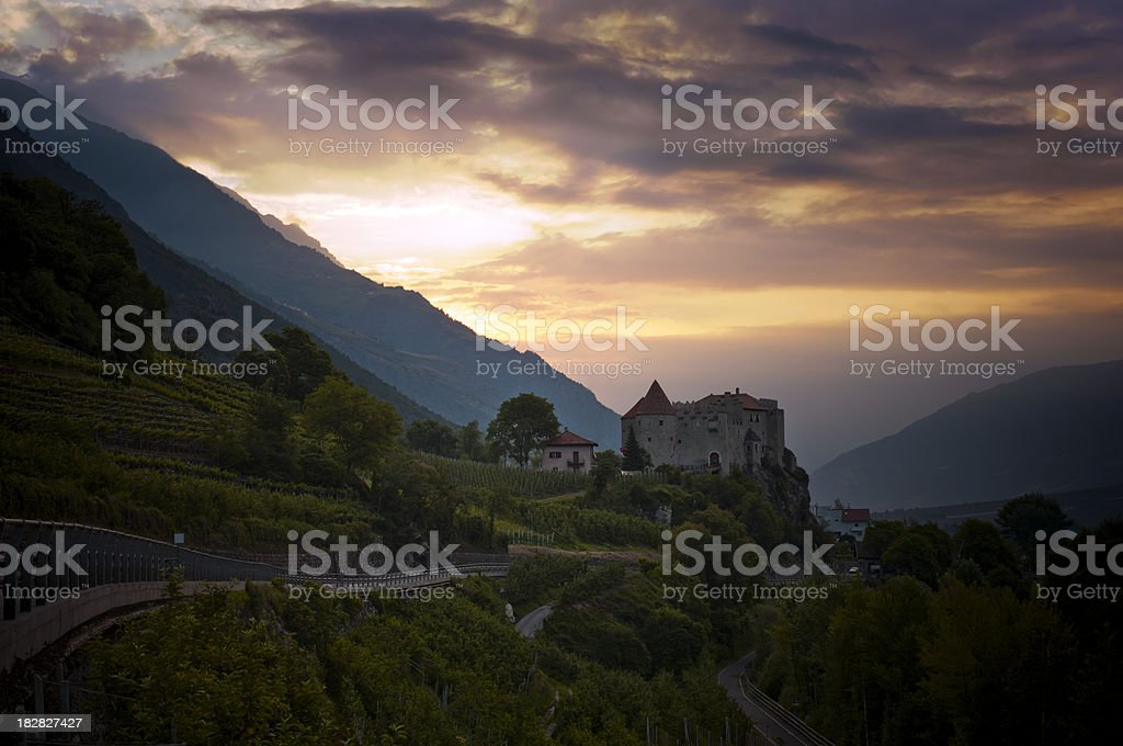 Sunrise with the Castle of Reinhold Messner stock photo