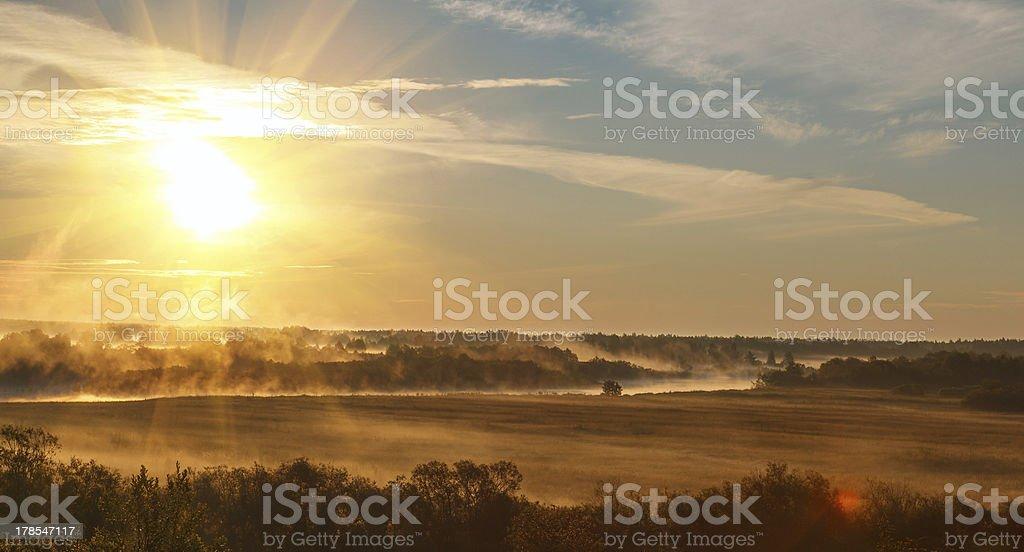 sunrise with the mist stock photo