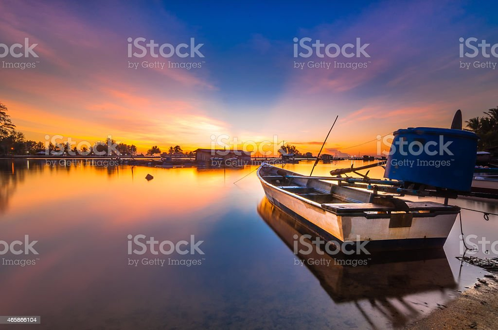 Sunrise with the single boats stock photo