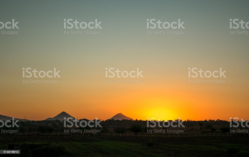 Sunrise with two Volcanos in the Background royalty-free stock photo