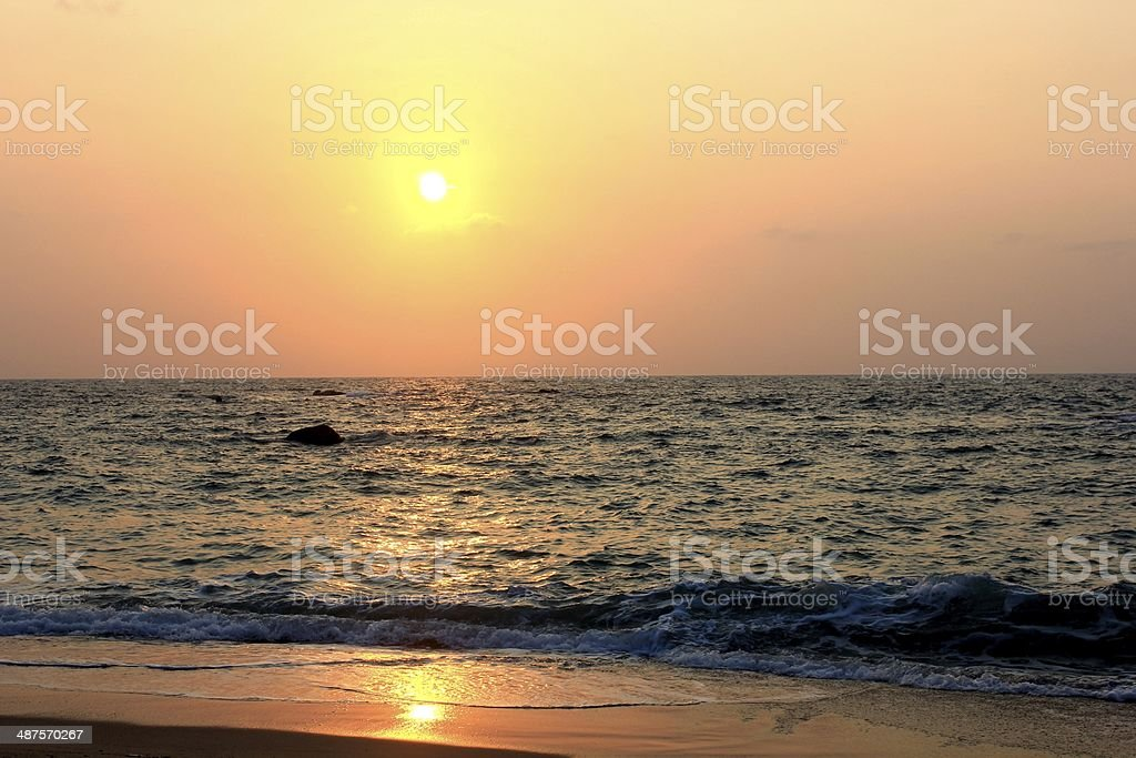 sunrise with wave on beach royalty-free stock photo