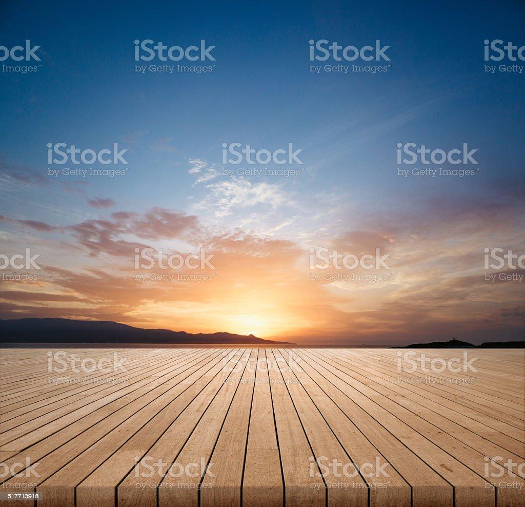 Sunrise  with wood flooring stock photo