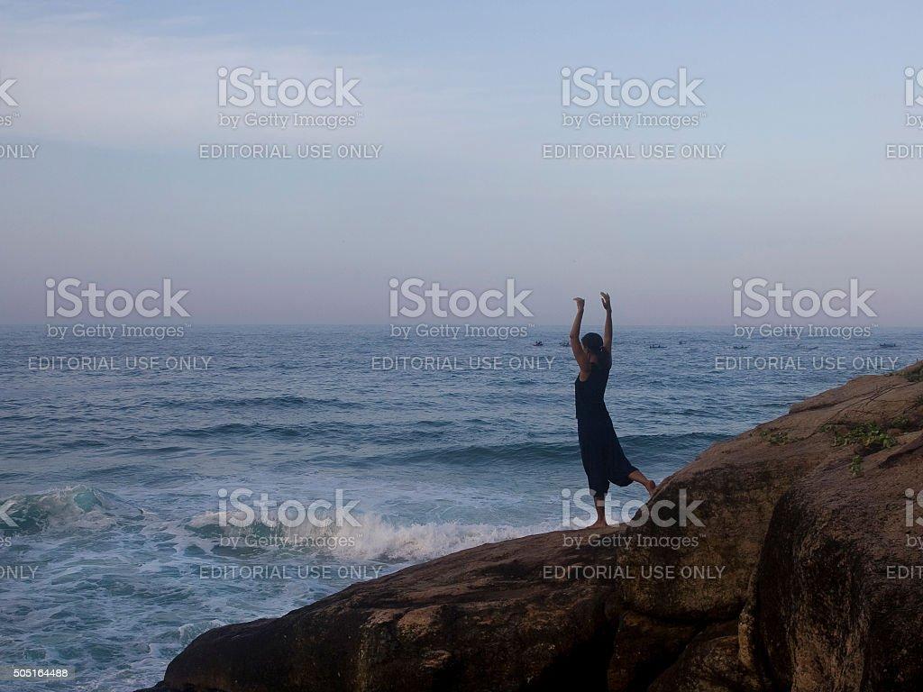 Sunrise yoga stock photo