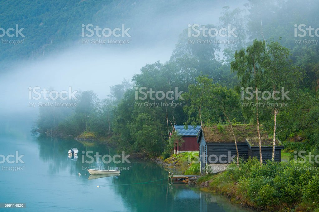 Sunrize on a foggy lake in Norway stock photo
