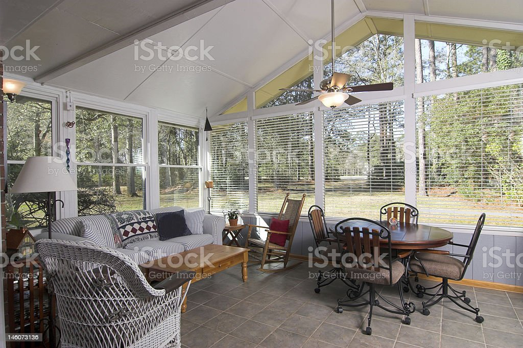 sunroom looking onto golf course stock photo