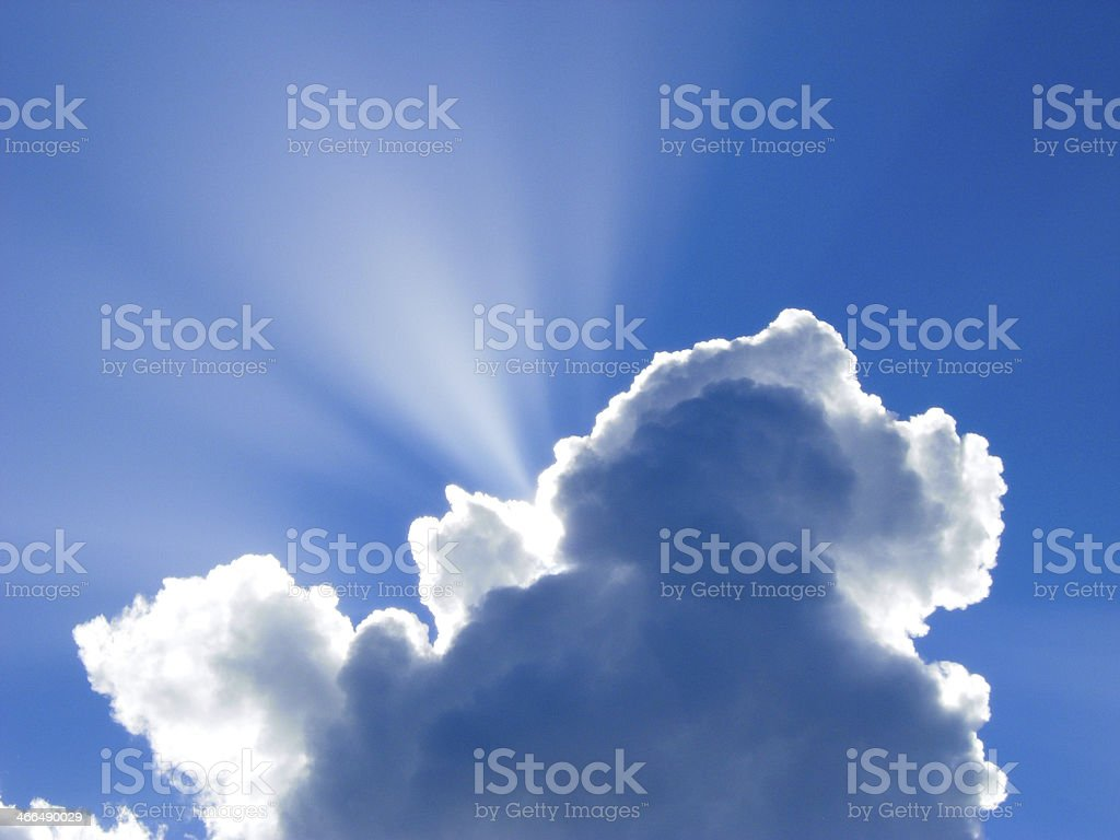 Suns Rays and Clouds stock photo