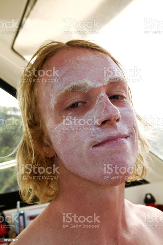 Sunscreen on face stock photo