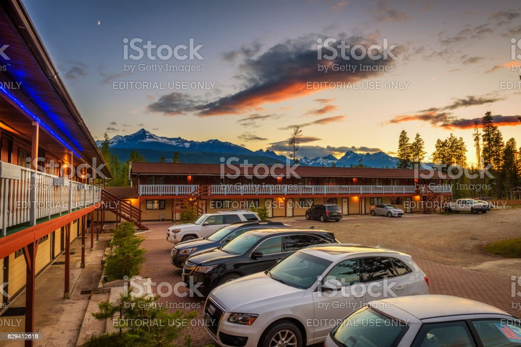 Sunset above Rocky Mountains and the Rocky Inn in Valemount, Canada stock photo