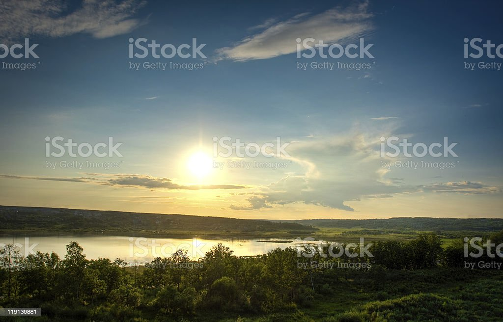sunset above the lake royalty-free stock photo
