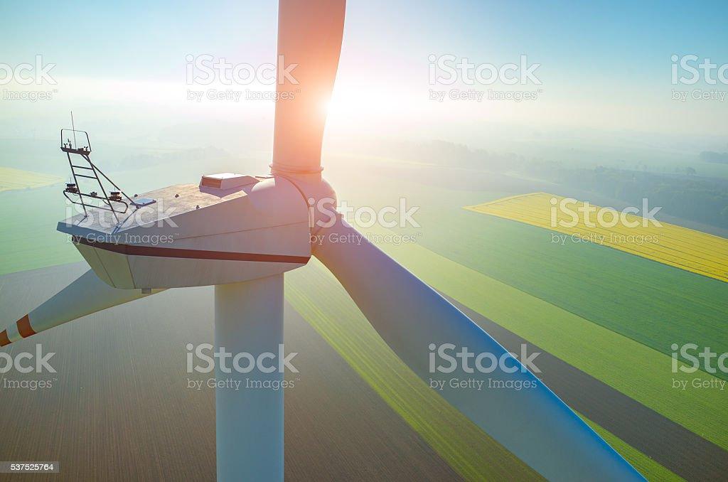Sunset above the windmills on the field stock photo