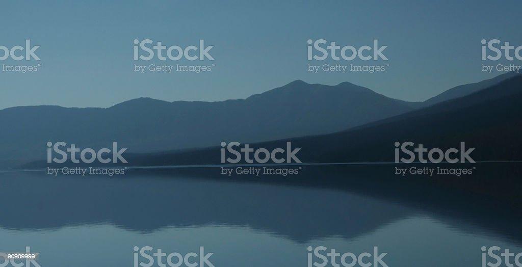 Sunset abstract,mountain  reflections on McDonald Lake stock photo