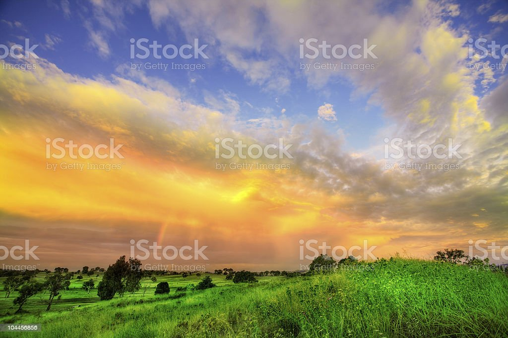 Sunset across a field royalty-free stock photo