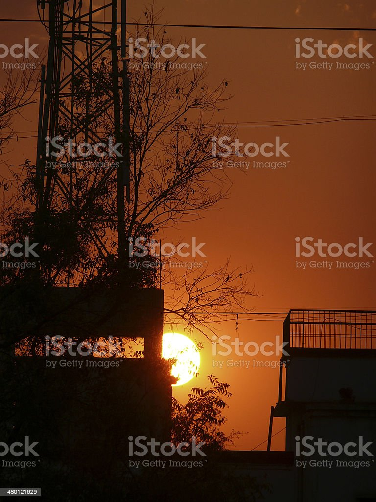 Sunset against a mobile tower stock photo